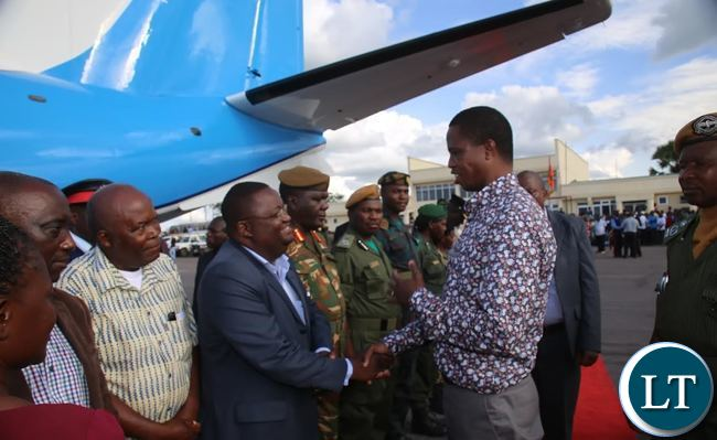 PRESIDENT Edgar Lungu confers with Luapula Province Permanent Secretary Dr. Buleti Nsemukila at Mansa airport shortly before departure for Lusaka. This was after the President concluded his tour of the province