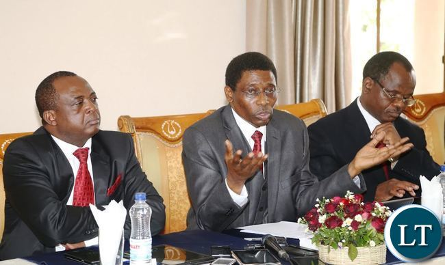 National House of Prayer Advisory Board Chairperson Bishop Joshua Banda speaking during press briefing whilst His Vice Chairperson Rev: Pukuta Mwanza (r) and Board Member David Nama (l) listens