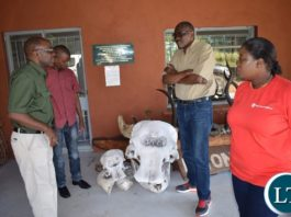 Tourism and Arts Minister Charles Banda listening to Director of National Parks (left) as Sioma Member of Parliament Mbololwa Subulwa (right) listens. PICTURE: SAKABILO KALEMBWE