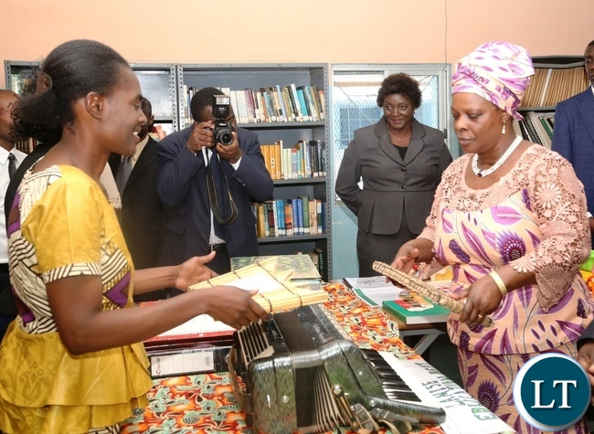 Zambia Institute of Special Education Music Lecturer Janet Kapepelesha(l) explaining to the First Lady Esther Lungu(r) the use of the Music Instrument as the First Lady Toured the School Library at Zambia Institute of Special Education yesterday,3-3-2017, Picture by Ennie Kishiki/Zanis.