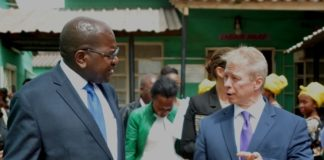 Minister of Health Chitalu Chilufya(l) and United States of America Ambassador to Zambia Eric Schutz(r) chats after a Press Briefing at Ng'ombe Health Centre in Lusaka