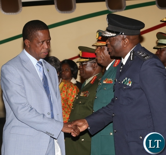 President Edgar Lungu(l) being welcomed by Inspector of Police Kakoma Kanganja(r) as he arrives from Israel last night around 19:04.Picture by Ennie Kishiki/Zanis.