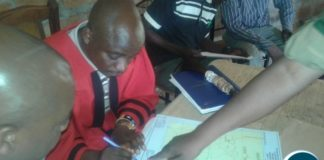 Chief Machiya of the Lamba speaking people in Mpongwe signs a consent giving the zambia army access to 2000 hecters for cultivation purposes. picture by Keith Maila.