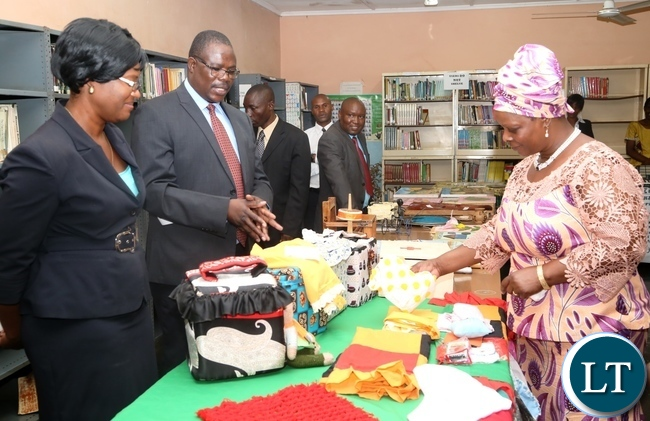 Zambia Institute of Special Education Senior Lecturer Regina Chilufya(l) and head of Department Cassidy Sakala(c) explaining to the First Lady Esther Lungu(r) as the First Lady visited the institution yesterday,3-3-2017, Picture by Ennie Kishiki/Zanis.