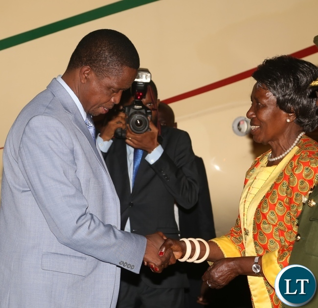 President Edgar Lungu(l) being welcomed by the Vice President Inonge Wina(r) as he arrived from Israel last night around 19:04.Picture by Ennie Kishiki/Zanis.