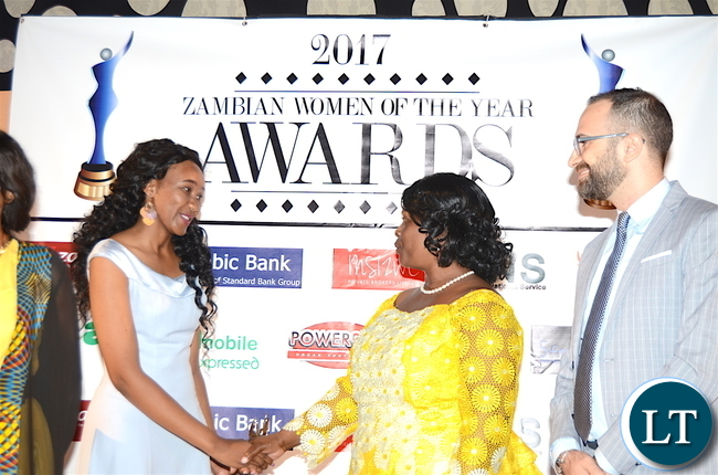 First Lady Esther Lungu congratulates First Female Fighter Pilot Thokozile Muwamba for scooping the Woman of the Year award during the Afro Multi Media Productions Women of the Year Awards giving Ceremony to mark the International Women's Day Celebrations at Government Complex in Lusaka on Tuesday, March 7,2017 -Picture by THOMAS NSAMA