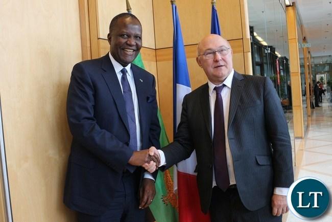 Finance Minister Felix Mutati (L)