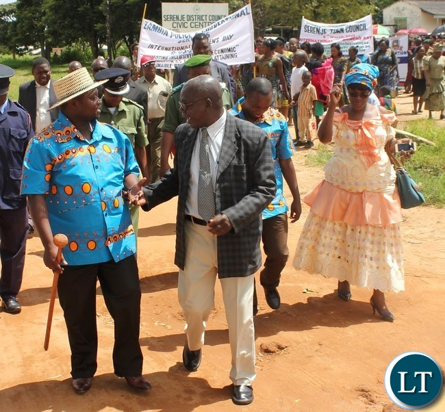 Serenje District Commissioner Fracis Kalipenta (Centre), Serenje District Council Secretary Pamela Zulu (Right) and Serenje District Council Chairperson Chester Kasonde (Left) lead marchers to the National square where this year's district International Women's Day was commemorated from.