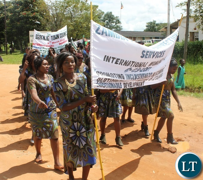 Women from the Zambia Police and correctional service in Serenje district marching during this year's district International Women's Day whose theme was women in the changing world of work: Planet 50:50 by 2030.