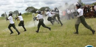 IN RIOT GEAR: Police women in Serenje district demonstrate how Police quail riots. This was during the commemoration of the International women's day in Serenje district held at the national square.