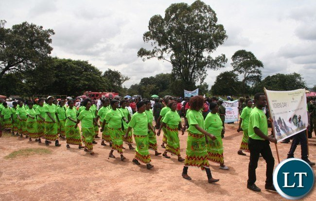Women from Kansanshi mine marching during the commemoration of International Women Day at Youth Grounds in Solwezi on Wednesday. PICTURE BY BETRAM KAOMA /ZANIS
