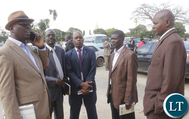 Some club officials waiting outside Lusaka Government Complex banquet hall.