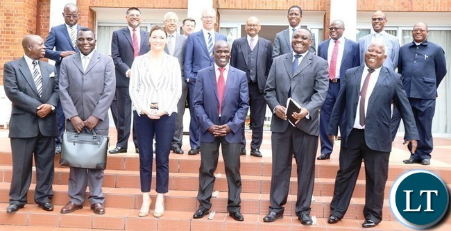 President Edgar Lungu (behind) poses for the picture with vedanta resources team after having a meeting at state house today . Picture by SUNDAY BWALYA /. ZANIS