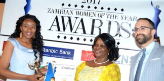 First Lady Esther Lungu presents the Woman of the Year Award to First Female Fighter Pilot Thokozile Muwamba during the Afro Multi Media Productions Women of the Year Awards giving Ceremony to mark the International Women's Day Celebrations at Government Complex in Lusaka on Tuesday, March 7,2017 -Picture by THOMAS NSAMA