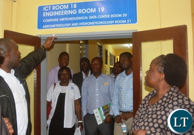 Senior Meteorological Officer Victor Bupe show Ministry of transport and communication Human Resources Director at Bridget Mukuyamba and other transport and communication officials during the tour in Lusaka
