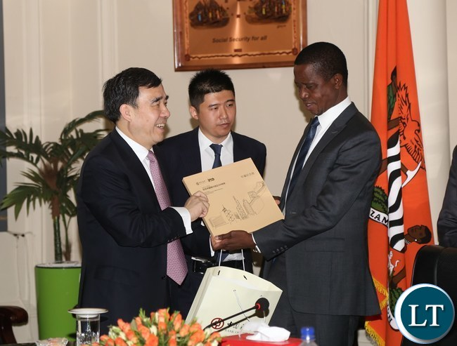 President Edgar Lungu receives a gift from Chairman of the Board of Directors Bank of China Guoli Tian when he called on him at State House