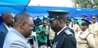 LUAPULA Province Permanent Secretary Dr. Buleti Nsemukila conferring a medal of bravery to Assistant Superintendent Phiri Admarks during the Zambia Police Open Day cerebration in Mansa over the weekend.