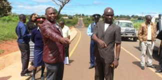 Mbala District Commissioner Kedrick Sikombe (right) and Mayor Brighton Sindeya (brown suit) inspects the newly constructed 10.4km township roads by China Camc today. Looking on is Mbala town Clerk Benson Bweenge .:- picture by Mary Bwembya (ZANIS).