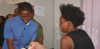 President Edgar Lungu(l) getting the New Born Baby from the Mother Racheal Jere of Matero Compound during his tour of Matero First Level Hospital in Matero yesterday,22-04-2017. Picture by Ennie Kishiki/Zanis.