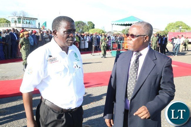 Western Province Minister Nathaniel Mubukwanu and his Permanent Secretary Mwangala Liomba await the arrival of the President at Mongu airport