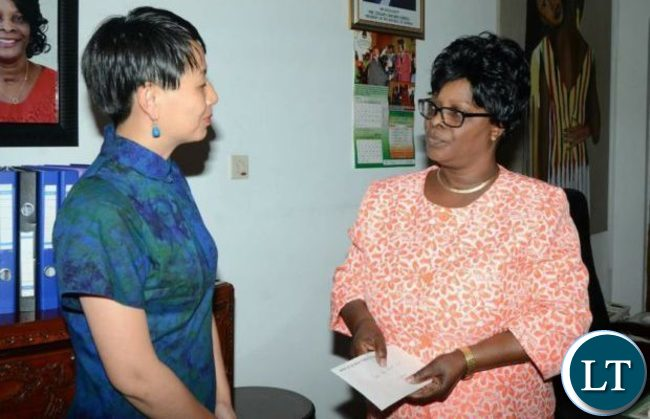 Ambassador Yang Youming wife talks to First Lady Esther Lungu at State House on Tuesday, April 4th 2017