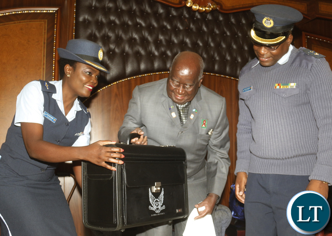 Zambia Air Force chief General Eric Chimese presenting to KK a pilot bag as a gift his 93rd birthday at his home in State lodge area.