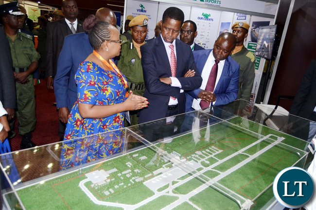 President Lungu listens to Zambia Airports Director- Airport Services Agness Chaila (L) as Minister of Housing and Infrastructure development Ronald Chitotela (R) during the Exhibition on the sideline of the 2017 Housing and Infrastructure Symposium at Mulungushi International Conference Centre in Lusaka on Thursday,April 20,2017 -Picture by THOMAS NSAMA