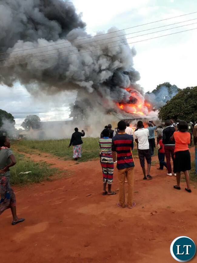 People watch as Chalimbana University burns