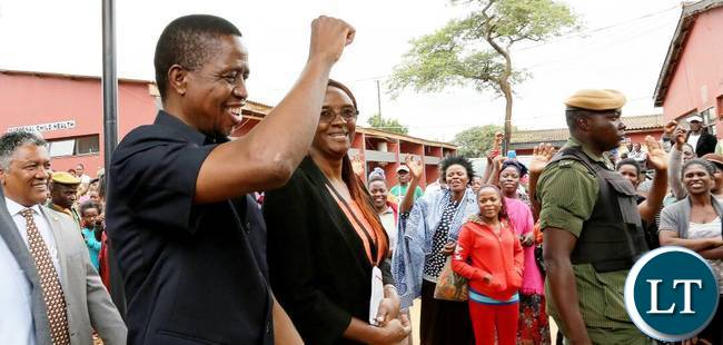 President Lungu gestures to the people on arrival at Chilenje Level 1 Clinic