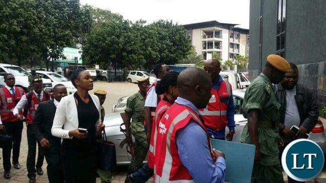 ZICTA officers storming the CEC Liquid Telecom Headquarters