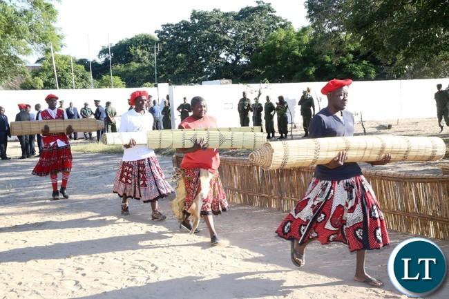 Likombwa caring the Traditional carpet for the King Imwiko ii  to the  Nalikwanda at Lealui Palace