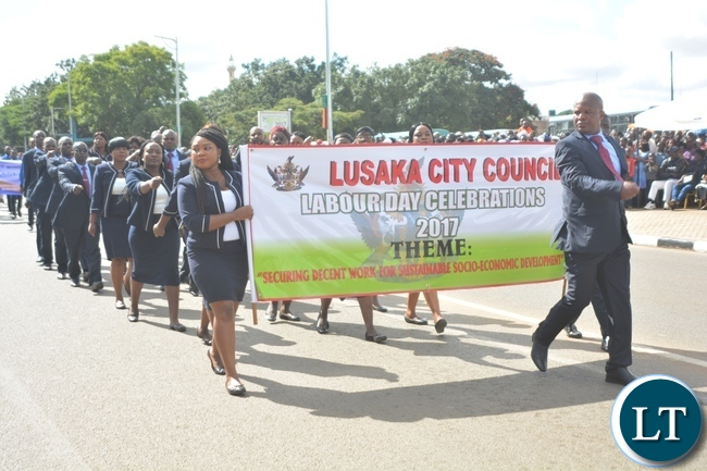 Lusaka City Council Staffs matching during the Labour Day Celebration in Lusaka yesterday,01052017.Picture by Ennie Kishiki/Zanis.