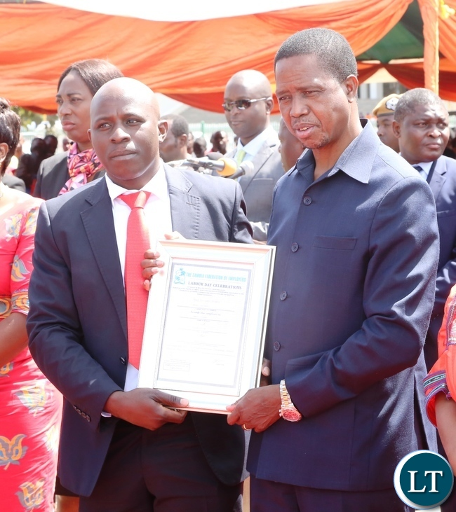 President Edgar Lungu presents a certificate to Arnold Sondashi for the Most courageous worker award during 2017 Labour Day Celebration at Freedom Statue yesterday 01-05-2017. Picture by ROYD SIBAJENE/ZANIS