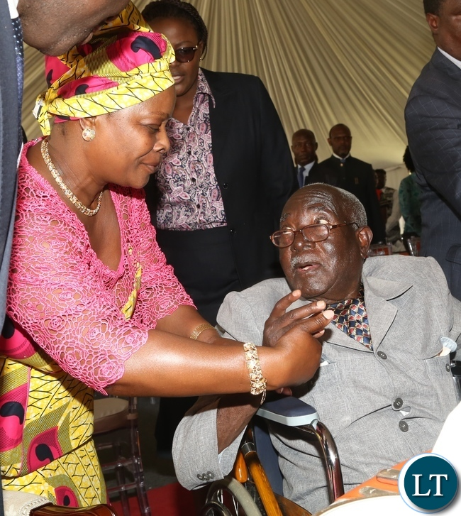 First Lady Esther Lungu greets freedom fighter Grey Zulu during the Africa Freedom Day at State House