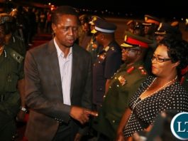 President Edgar Lungu chats with PF Deputy Secretary Genral Mumbi Phiri shortly after he arrived Nothern Province yesterday 27-05-2017. Picture by ROYD SIBAJENE/ZANIS