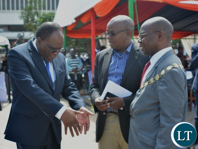 Secretary to Cabinet Roland Msiska(l) chats with Lusaka Mayor Wilson Kalumba(r) and Town Clerk Alex Mwansa(c) during the Labour Day Celebration in Lusaka yesterday,01052017.Picture by Ennie Kishiki/Zanis.