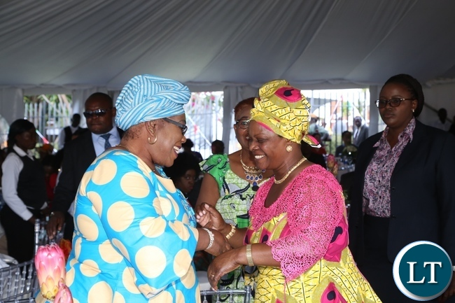 First Lady Esther Lungu greets former First Lady Vera Chiluba during the Africa Freedom Day at State House