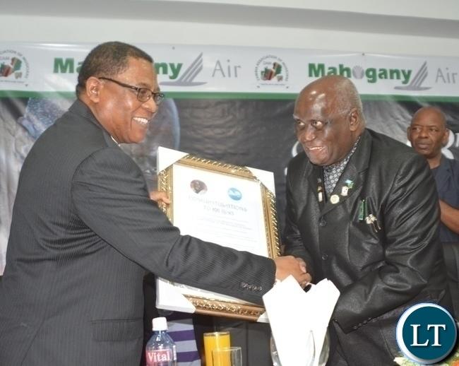COMESA Secretary General Sindiso Ngwenya(r) presents a gift to First Republican President Kenneth Kaunda(l) during Zambia Association of Musician KK's Birthday Bash in Chongwe