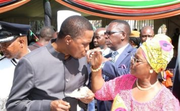 First Lady Esther Lungu feeds President Edgar Lungu a cake shortly after cutting it during the Africa Freedom Day at State House