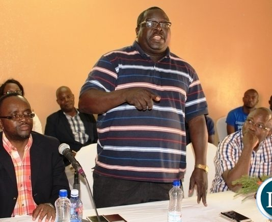 Roan Member of Parliament and member of the Parliamentary Committee on Health, Community Development and Social Services, Dr. Chishimba Kambwili, addresses Masaiti residents during a public hearing by the committee in the district