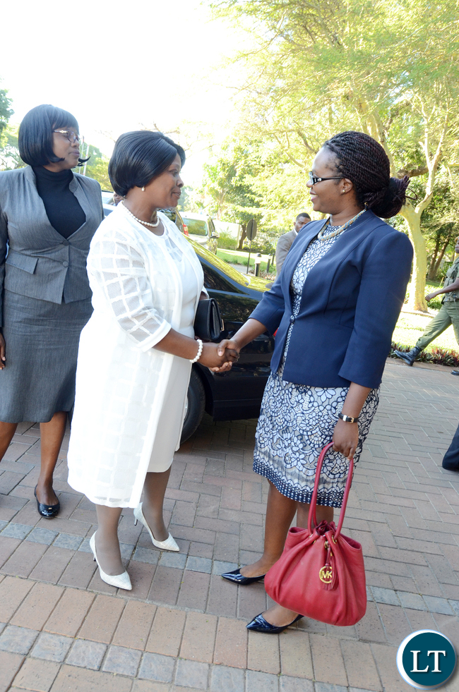 First Lady Esther Lungu talks to LAZ president Linda Kasonde as LAZ Executive Director Edward Sakala (R)after the Breakfast meeting to celebrate achievements of the National Legal Aid Clinic for Women in the provision of Legal Aid servicea in Zambia at Taj Pamodzi Hotel on Thursday,May 11,2017 -Picture by THOMAS NSAMA