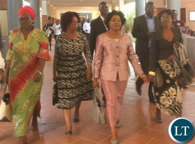 Hichilema's wife Mutinta (in peach) leaving magistrate court after judgement date was set in the insulting language case.