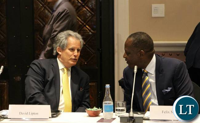 IMF First Deputy Managing Director David Lipton confers with Finance Minister Felix Mutati in Livingstone.