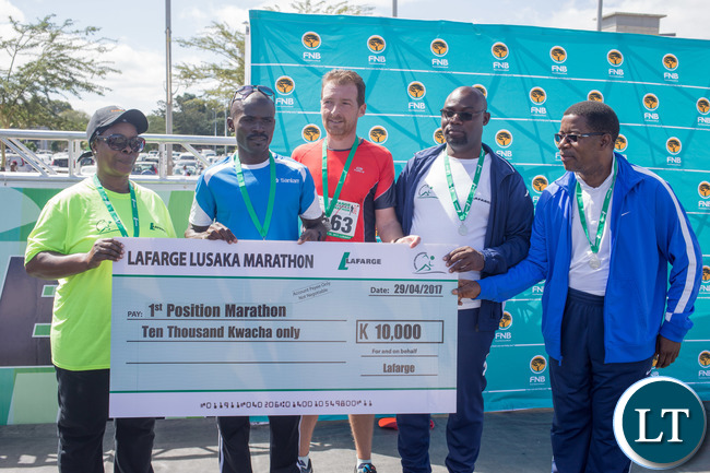 L-r, First Lady Madam Esther Lungu, Mathew Mutanya Marathon Winner , Lafarge CEO Vincent Bouckaert, The Minister of Youths and Sports Mr Moses Mawere and ZAAA president Mr Elias Mpondela