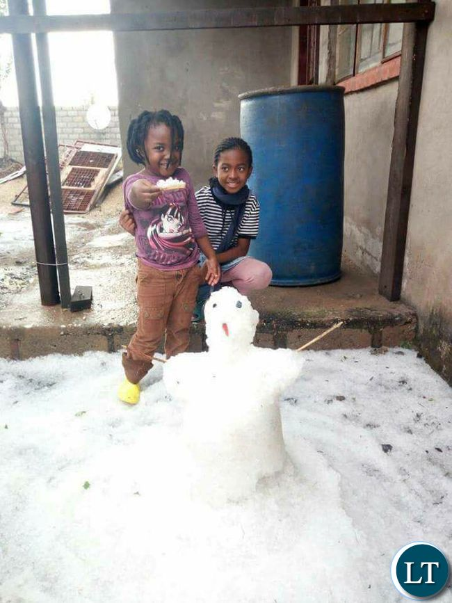 Some children in Lusaka playing with 'Snowman'