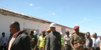 PRESIDENT Edgar Lungu inspecting construction of new houses on arrival at KARA Barracks in Kawambwa where Government is constructing 995 Housing units for the 48 Marine Commandos.