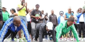 Health Minister Dr.Chitalu Chilufya,First Lady Esther Lungu and President Edgar Lungu doing some press ups during the official launch of the 2017 National Health Week at the Olympic Youth Development Centre