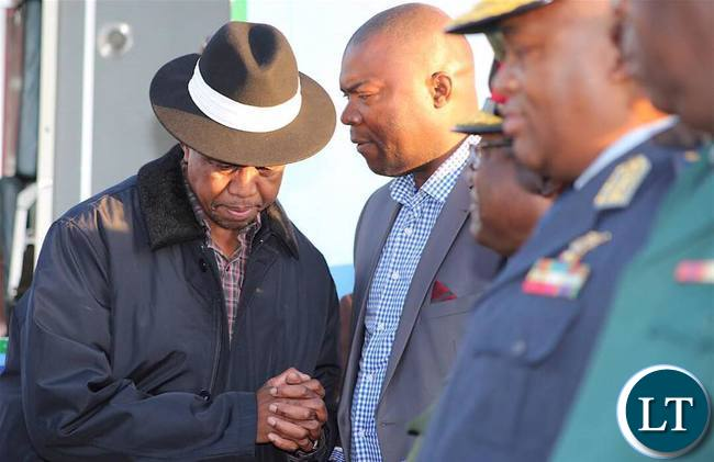 Copperbelt Minister Bowman Lusambo chats with President Lungu at Simon Mwansa Kapwepwe in Ndola on Wednesday evening