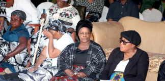First Lady Esther Lungu pays her last respects to her late brother James Phiri during burial in Chongwe District on Friday, June 23,2017 –Picture by THOMAS NSAMA