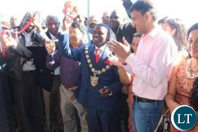 Luanshya Mayor Nathan Chanda cutting the ribbon during the opening of Roan Mall